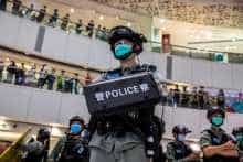 A riot police officer stands guard during a clearance operation during a demonstration in a mall in Hong Kong