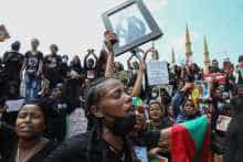 Members of the Oromo Ethiopian community in Lebanon take part in a demonstration to protest the death of musician and activist Hachalu Hundessa, in the capital Beirut on July 5, 2020
