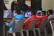 In this picture taken on January 4, 2018, high school students play online games at a shop in Hanoi
