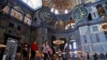 People visit the Hagia Sophia or Ayasofya, a UNESCO World Heritage Site which was a Byzantine cathedral before it was converted into a mosque and currently a museum, in Istanbul, Turkey