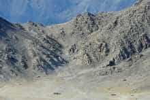 Indian soldiers walk at the foothills of a mountain range near Leh, Ladakh