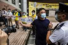 Pro-democracy district councillors protest outside the hospital authority headquarters in Hong Kong against the government's decision to have mainland inspectors carry out coronavirus testing in Hong Kong.