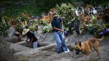 emetery workers dig new graves at the Xico cemetery on the outskirts of Mexico City, as the coronavirus disease (COVID-19) outbreak continues in Mexico, July 31, 2020