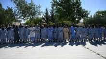Taliban prisoners stand during their release from the Bagram prison, next to the US military base in Bagram, some 50 km north of Kabul. Afghan authorities plan to release 900 more Taliban prisoners on May 26, as calls grow for the militants to extend a ceasefire on its third and final day.