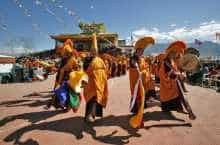 Buddhist nuns perform a religious dance called Nga Chham, outside the Naro Photang Puspahari temple in Shey, near Leh