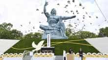 Doves fly over the Peace Statue in Nagasaki's Peace Park during a ceremony commemorating the 75th anniversary of the bombing of the city, in Nagasaki, Japan, in this photo released by Kyodo August 9, 2020
