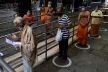 Devotees maintain social distancing at a temple in Chennai.