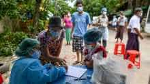 Health workers register residents during a medical checkup and contact tracing campaign in Yangon on September 9, 2020, as authorities worked to halt the spread of the COVID-19 coronavirus.