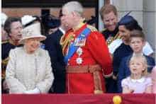 Britain's Queen Elizabeth II, Britain's Prince Andrew, Duke of York, Harry and Meghan with other members of the Royal family on the balcony of Buckingham Palace in London