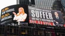 Images of Ivanka Trump and Jared Kushner are seen alongside messages about coronavirus disease (COVID-19) infections and deaths on billboards sponsored by The Lincoln Project above Times Square in New York City