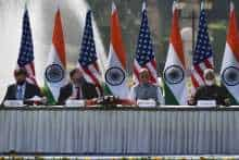 US Secretary of Defense Mark Esper, US Secretary of State Mike Pompeo, India's Defence Minister Rajnath Singh and India's Foreign Minister Subrahmanyam Jaishankar attend a joint press briefing in the lawns of Hyderabad House in New Delhi