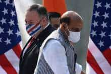 US Secretary of State Mike Pompeo (L) and India's Defence Minister Rajnath Singh arrive to address a joint press briefing in the lawns of Hyderabad House in New Delhi