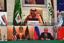 Saudi King Salman bin Abdulaziz gives an address opening the G20 summit, held virtually due to the COVID-19 coronavirus pandemic, while below him are pictured outgoing US President Donald Trump and Russian President Vladimir Putin.