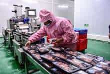 A worker packaging pork at a meat packing facility in Shenyang in China's northeastern Liaoning province.