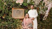 Bakhtawar Bhutto Zardari poses with her fiance Mahmood Choudhry in front her late mother Benazir Bhutto's portrait