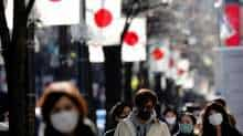 Pedestrians wearing protective masks, amid the coronavirus disease (COVID-19) outbreak, make their way at Ginza shopping district which closed to cars on Sunday in Tokyo, Japan, January 10, 2021