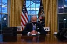 US President Joe Biden sits in the Oval Office at the White House in Washington, DC