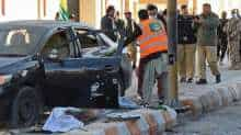 Policemen inspect the site of a bomb attack during a rally that was organised to mark Kashmir Solidarity Day in Quetta