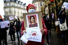 A demonstrator holds a portrait of Aung San Suu Kyi, during a protest against the military coup