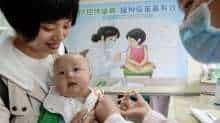 A child receives a vaccination at a hospital during China's National Child Vaccination Awareness Day in Handan in China's northern Hebei province