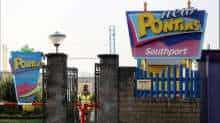 A file photo of a soldier guarding the gate of the Pontins Southport Holiday Park in Ainsdale, Britain.