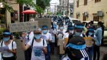 Demonstrators march during a protest against military coup in Yangon, Myanmar April 12, 2021