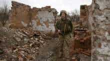 A Ukrainian serviceman patrols near the frontline with Russia backed separatists near small city of Marinka, Donetsk region on April 12, 2021.