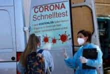 A medical worker carries out testing operation at a mobile corona rapid test centre in Berlin