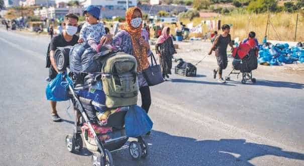 Migrants moved to new camp on Lesbos after fire burnt Moria Camp