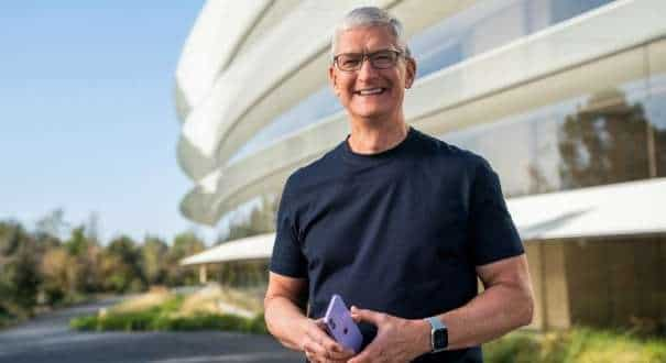 Apple CEO Tim Cook holds an iPhone 12 in a new purple finish, in this still image from the keynote video of a special event at Apple Park in Cupertino, California, U.S. released April 20, 2021