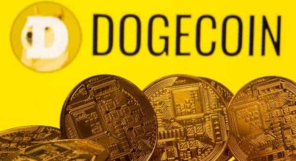 Cryptocurrency representations are seen in front of the Dogecoin logo