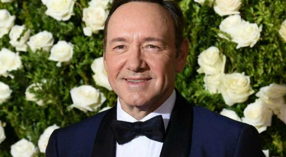 Kevin Spacey spotted singing and playing guitar along with a