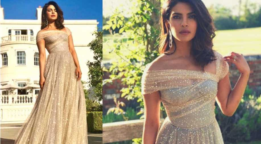 priyanka chopra shimmers in a dior gown at prince harry and meghan markle s wedding reception india news news wionews com priyanka chopra shimmers in a dior gown