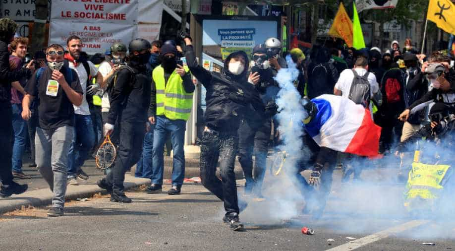 French police fire tear gas at protesters in Paris May Day