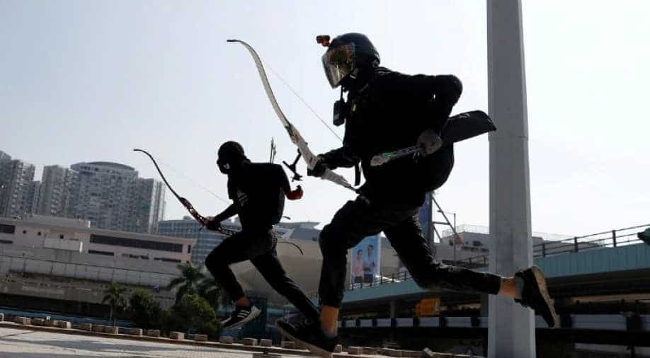 Rioters are getting ready to fatal attack police with bows and modified sharp arrows stolen from sports department of the university