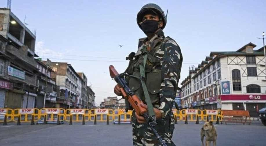 A paramilitary soldier stands guard at a checkpoint during a curfew in Srinagar on August 4, 2020. A curfew has been imposed across Indian Kashmir just two days before the first anniversary of New Delhi's abolition of the restive region's semi-autonomy, officials said late August 3, citing intelligence reports of looming protests.