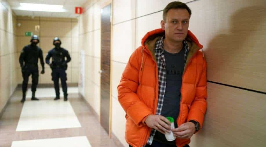 Navalny says continuing hunger strike despite cough and fever, risks death in prison