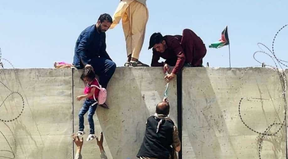 Heartbreaking: Desperate Afghan mothers throw children over Kabul airport fence in bid to escape Taliban, South Asia News   wionews.com